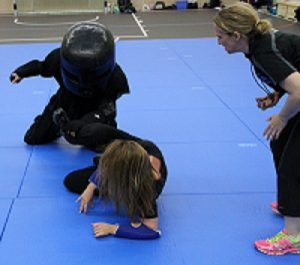 Student defends herself against the padded assailant in the Model Mugging Basic women's self defense course.